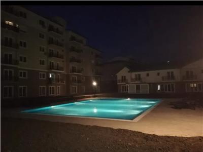 Casa Cosmopolis la piscina